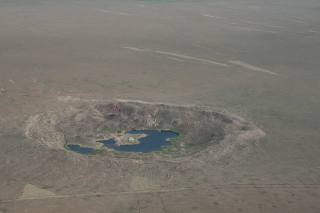 A number of craters created from nuclear tests. Author:The Official CTBTO PhotostreamCC-BY 2.0