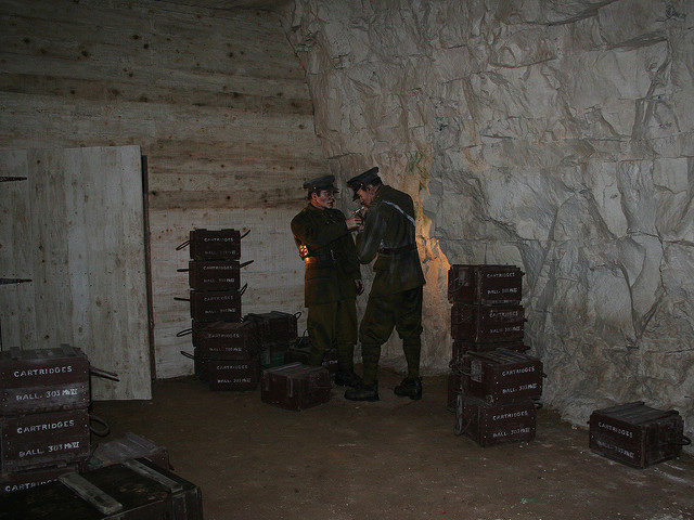 Soldiers and boxes of ammunition. Author:Jon's picsCC BY 2.0