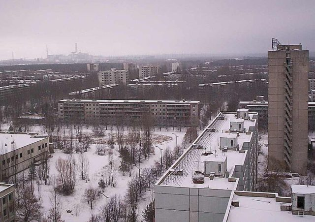 The city of Pripyat and the Chernobyl facility in the distance. Author:(WT-en) Kadams1970