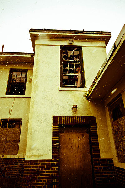 Boarded doors and windows in an attempt to prevent vandals from entering. Author:ShezammCC BY-SA 2.0