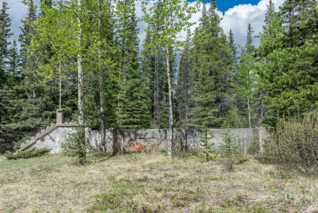 This photo shows a building foundation. The building has been removed and a forest has taken over the setting. These remains are left from the abandoned coal mining town of Bankhead located in Banff National Park, Canada.