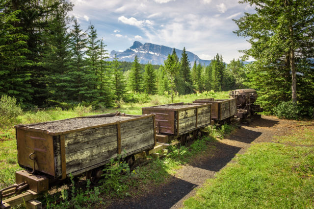 Historic coal mine train in the ghost town of Bankhead with Mt. Rundle in the background located in Banff National Park, Alberta, Canada.