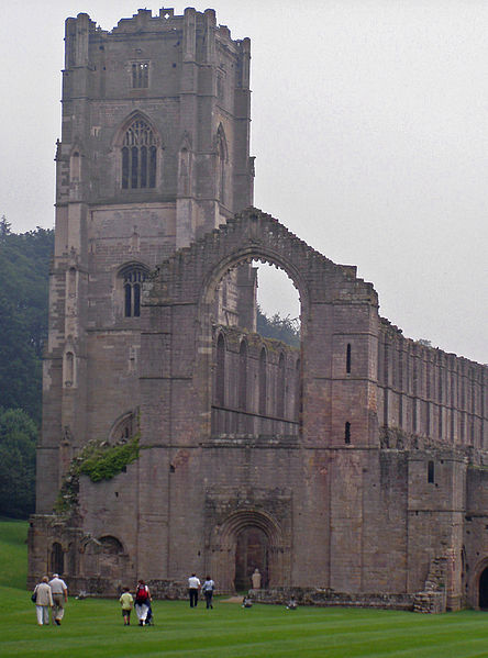 Part of the exterior of the abbey. Author:JohntesladePublic Domain