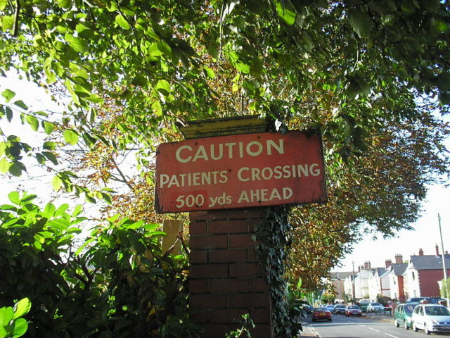 A sign warning of patients crossing. Author: Vaughan