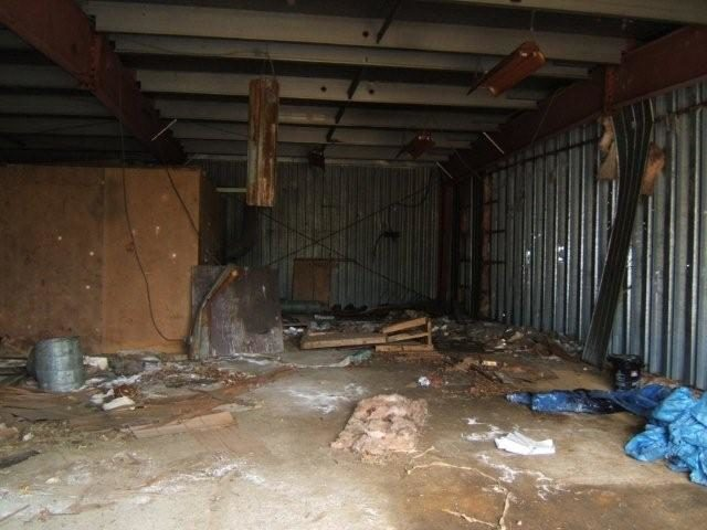 The interior of one abandoned building found at the mine site. Author:Black TuskCC BY 3.0