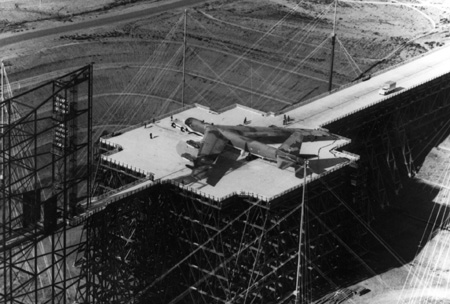 A Boeing B-52 placed on top of the wooden platform. Author:U.S. Air Force (courtesy Natural Resource Defense Council)