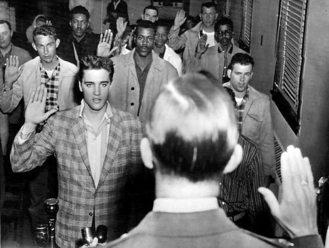 Elvis being sworn into the army. Author:Associated Press/Standard-SentinelPublic Domain