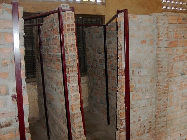 Former school rooms divided into cells. Author:Adam Carr –CC BY-SA 3.0