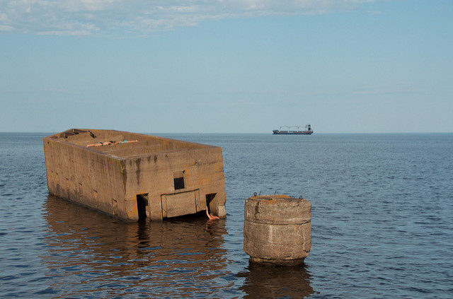 "Outside of the Duluth Shipping Canal is a concrete structure known as ""The Cribs"" or ""Uncle Harvey's Mausoleum"" – Author: Pete Markham – CC BY 2.0"