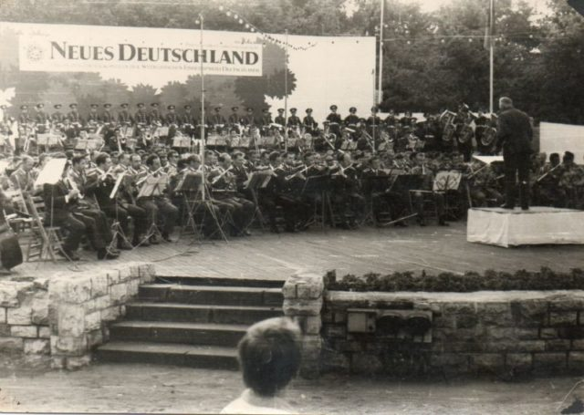 United military band of Poland, the Czech Republic and the GDR is performing at a festive event dedicated to the anniversary of the German socialist newspaper Neues Deutschland. Some of the musicians were from the orchestra of the 69th Motorized Rifle Regiment. Source: Private Archive