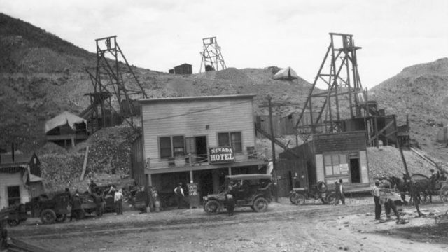 The Nevada Hotel, Office of Fidelity Securities Corporation Brokers and mines in Rawhide, c. 1910. A sign in front of the hotel reads: Car for Schurz at 11 a.m.