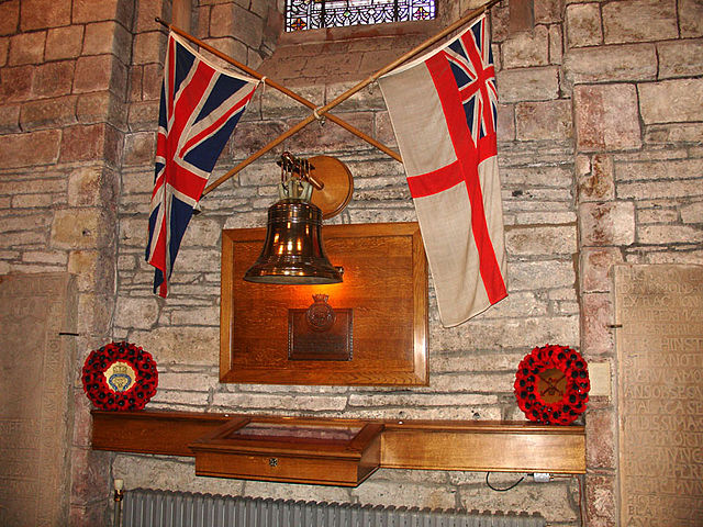 A memorial in St Magnus' Cathedral, Kirkwall, featuring Royal Oak's bell. Author: BillC CC BY-SA 3.0