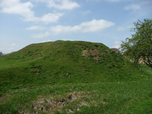 The motte and bailey castle was strategically placed beside a river crossing. Author:Iain Simpson CC BY-SA 2.0