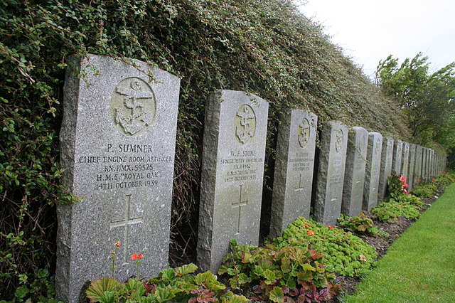 Headstones for some of the crew of Royal Oak; the majority remain on the sunken warship. Author: Des Colhoun CC BY-SA 2.0