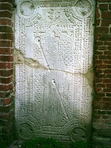 The gravestone of the abbot Johannes VII (died on 11th May 1473 ) is an amazingly elaborate piece of stonework. Author: Harald909 – CC BY-SA 3.0
