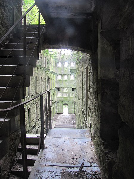 This view, looking from the restored area into an unrestored wing, gives an idea of what state it's in now. Bodmin Jail, Bodmin, Cornwall, England. Author:Robert Linsdell CC BY 2.0