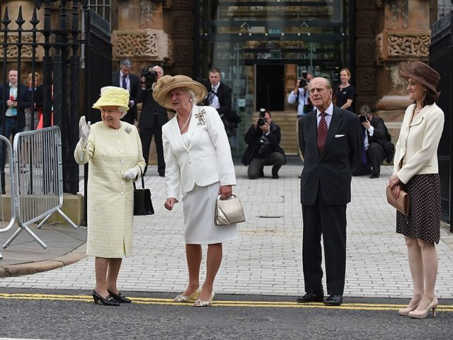 Queen Elizabeth and Prince Philip visited Crumlin Road Gaol, with Dame Mary Peters and NI Secretary of State, Theresa Villiers, June 24, 2014. Author:Northern Ireland OfficeCC BY 2.0