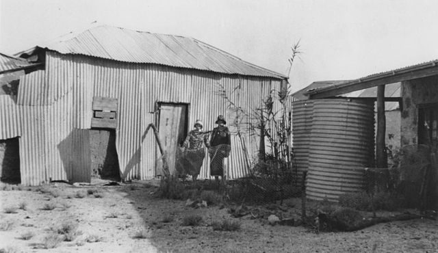 Nurses at the Australian Inland Mission at Birdsville, Queensland, ca. 1926 Sister Grimson and Sister Sherlock at the rear of the A. I. M. Hostel – Everitt, Cliff – Public Domain
