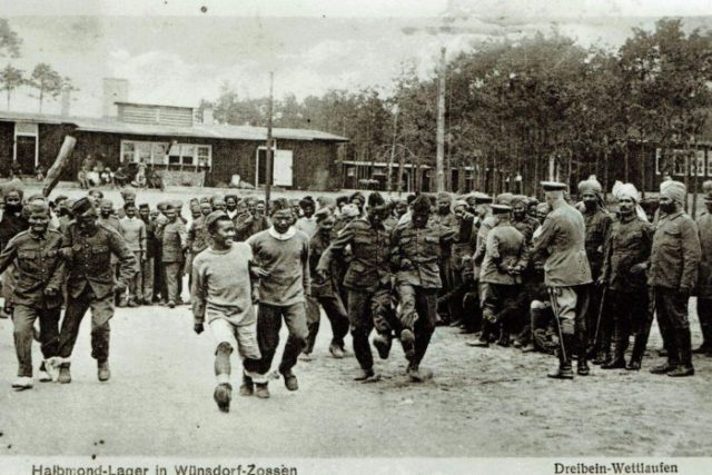 Indians and Zouaves as were also interned as POWs in the camp. These prisoners appear to be enjoying a three-legged race.