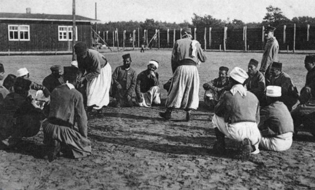 Not all of life was unpleasant at the camp. Some of the POWs can be seen here singing and dancing.