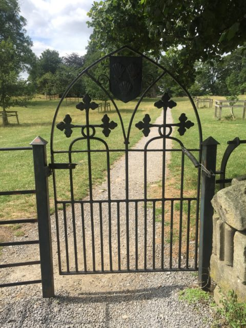Inside the abbey, looking out of the gate. Author: Charlotte Bond