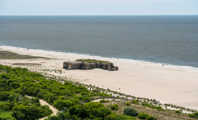 World War Two concrete bunker on the beach at Cape May Point in New Jersey. By BackyardProduction