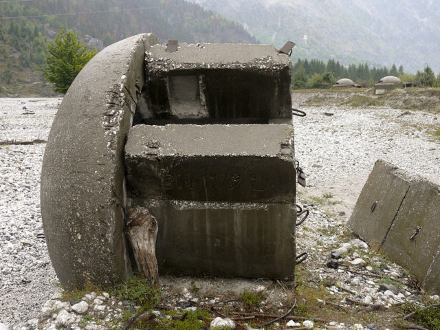 Bunker destroyed by river Valbona, Albania. By Jirka Dl – Own work, CC BY-SA 3.0