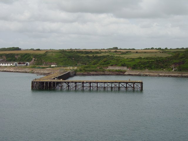 RNMD Milford with disused pier in the foreground. By Richard Webb, CC BY-SA 2.0