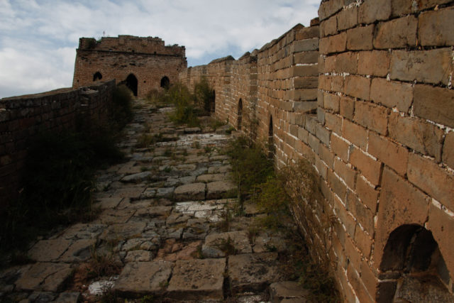 Ruined Cobblestone Path in the Great Wall of China. By Eduard Figueres