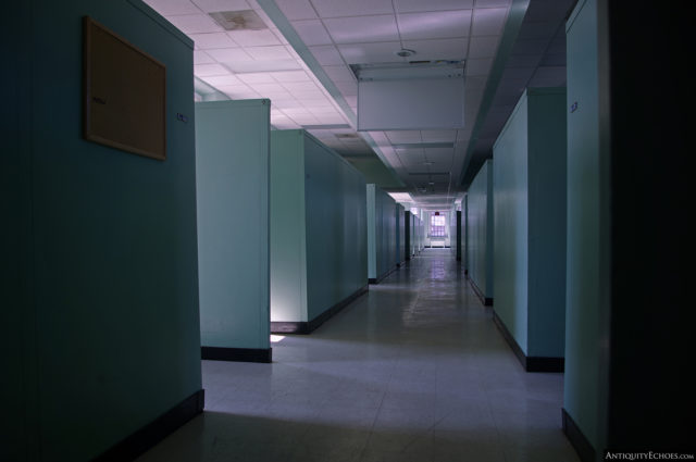 A partially-shadowed hallway in the Allentown State Hospital