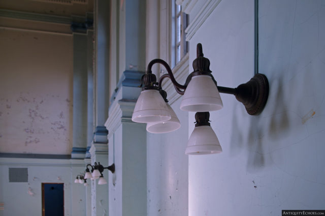Light fixtures on the wall of the hospital
