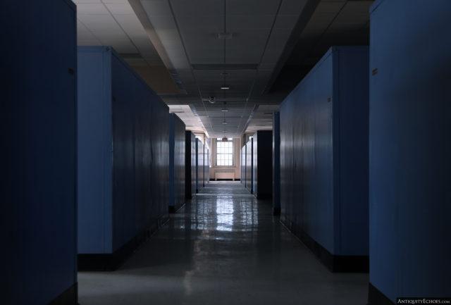 A shadowed hallway with blue walls