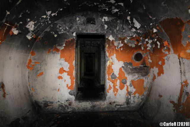 Remnants of orange paint peeling off Tuman bunker. (Photo Credit: CarloR)