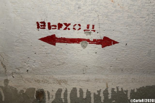 Sign containing a Russian word, giving directions in the bunker. (Photo Credit: CarloR)