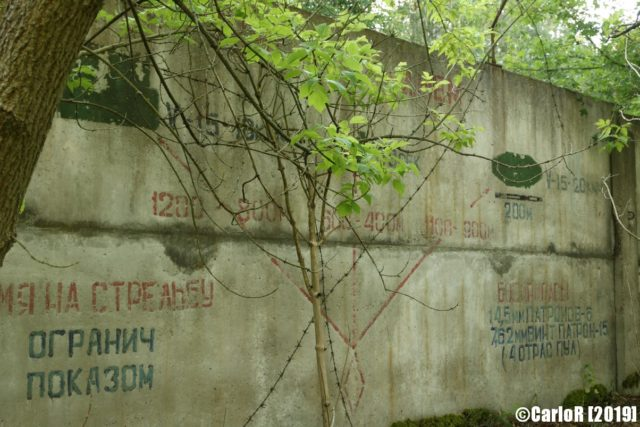 Exterior cement wall with writing on it