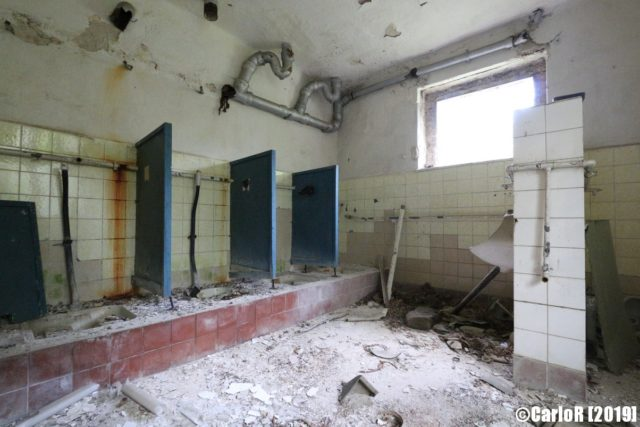 Deteriorating communal bathroom