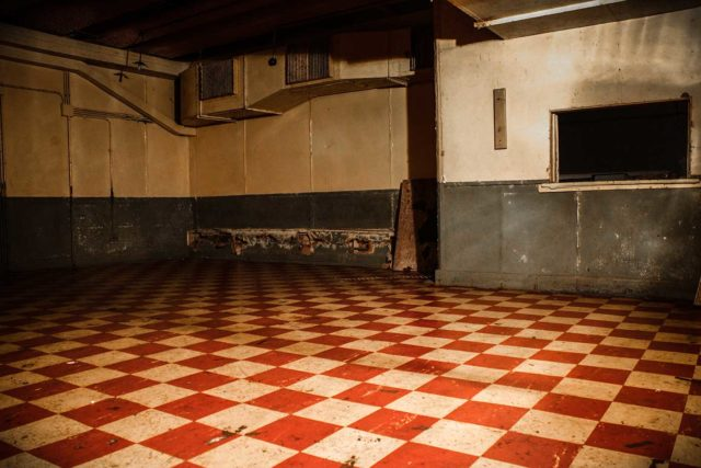 Empty room with a red and white tiled floor