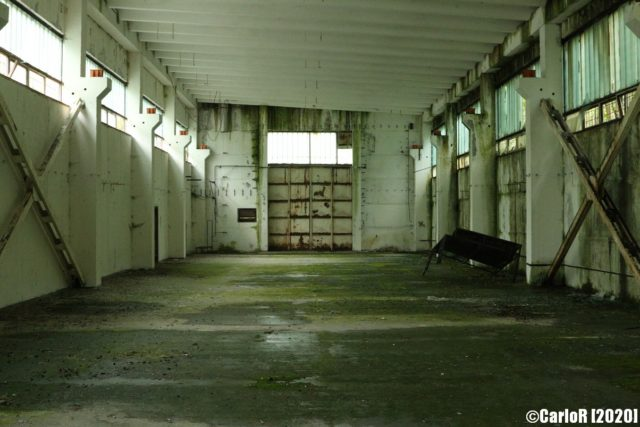 Empty room lit by upper windows