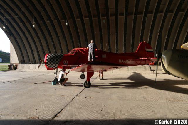 Red airplane inside a hangar