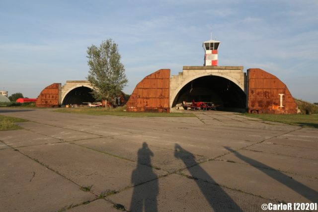 Exterior view of two airplane hangars at Tököl Airbase