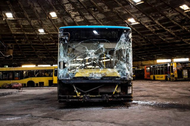 Abandoned bus with a smashed front window
