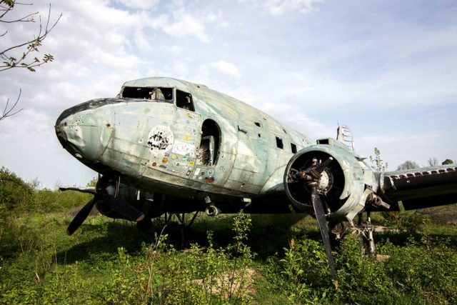 Abandoned Douglas C-47 airplane in the grass