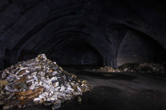Piles of rubble in a darkened room