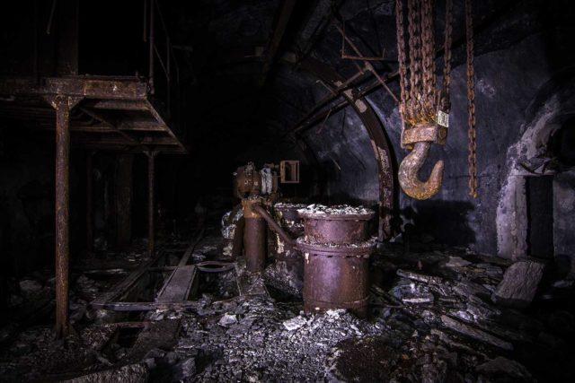 Rusty gas drum and metal hook