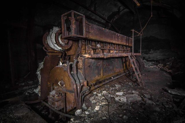 Rusty metal equipment in a dark room