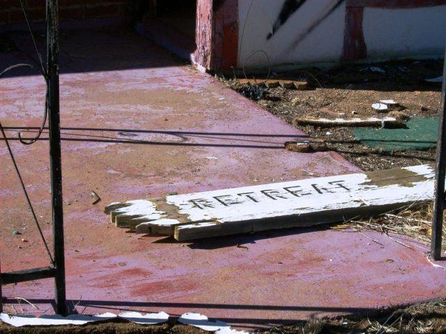 Broken wooden sign on the ground