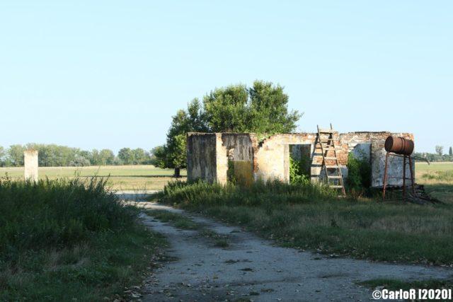 Gravel road beside a concrete building at Kalocsa Airfield
