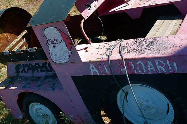 Close up of the first car of a pink children's train