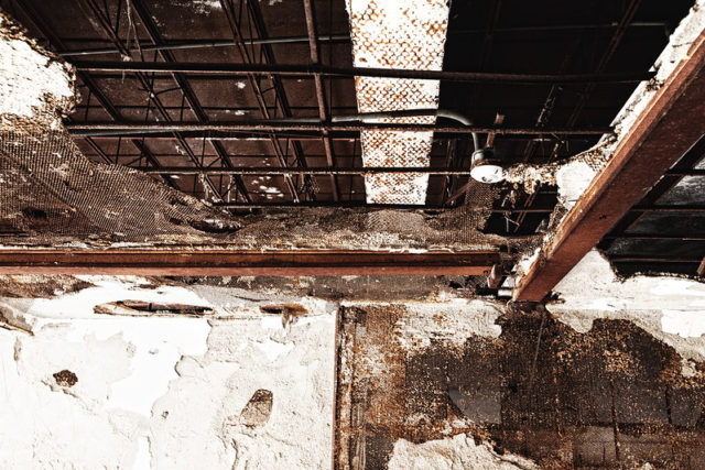 Exposed piping on the ceiling within the Burwash Correctional Center