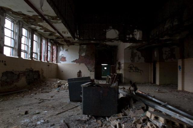 Darkened room with debris strewn across the floor